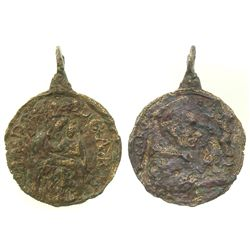 Small brass religious medallion with research letter.