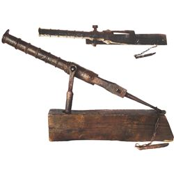 Iron breech-loading swivel cannon (rare), English, 1500s-1600s, with wooden block mount.