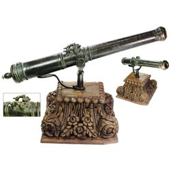 Bronze signal cannon with  sea dog  lifting handles, probably British, 1600s, with ornate mahogany s