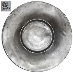 """Huge pewter """"bishop's hat"""" charger (wide-rimmed plate), late 1600s, with unidentified maker's mark."""
