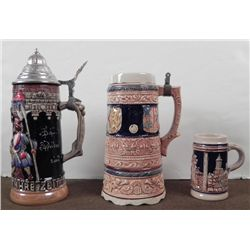 3 GERMAN STEINS-1 W/COVER-1 W/MUSIC WIND UP