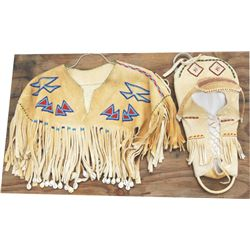 Beaded cape and cradle board