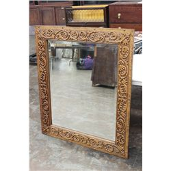 HEAVILY CARVED OAK  MIRROR