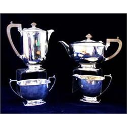 A PLAIN FOUR PIECE TEA SERVICE tea pot, water jug, sugar bowl and milk jug, raised on shaped foot, S