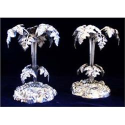 A PAIR OF 19TH CENTURY EPNS FOLIATE PALM LIKE TABLE CENTRE PIECES on shaped foliate base, 9  high (2