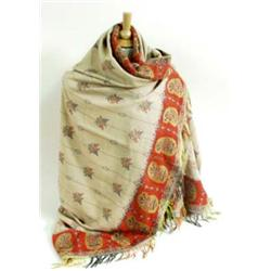 A PAISLEY SHAWL the ivory ground worked with all over floral motifs, with red paisley border and mul