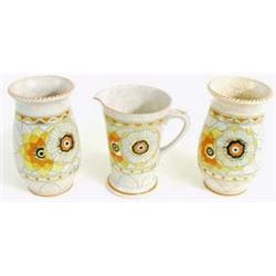 A PAIR OF CHARLOTTE RHEAD CROWN DUCAL VASES decorated Persian Rose pattern in stylised orange, yello