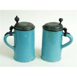 "A PAIR OF LATE 18TH CENTURY EARTHENWARE TANKARDS/STEINS with pewter lids, 7.5"" high £100-150..."