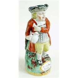 """A LATE 19TH CENTURY STAFFORDSHIRE TOBY JUG """"Hearty Good Fellow"""" with pipe and jug, in red coat and y"""