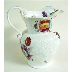 A HANDSOME OLD ENGLISH WHITE PORCELAIN JUG the body moulded raised flora and richly hand painted, as