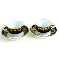 A PAIR OF NEW HALL CUPS AND SAUCERS bordered gold foliage on a blue ground (2) £60-100...