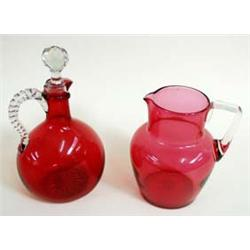 "A VICTORIAN CRANBERRY GLASS JUG with clear glass strap handle, 6.5"" high, together with a Victorian."