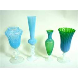 "A RIBBED BLUE VASELINE STYLE GLASS VASE on moulded scroll support raised a circular foot, 11"" high,."