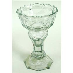 AN EARLY 19TH CENTURY CUT GLASS SWEET MEAT DISH the rim of the bowl cut with bevelled arches and spi