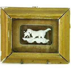 "A FINELY CARVED IVORY SPORTING DOG retreiving a duck, mounted an incised wood panel of trees, 2"" x 3"
