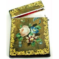 A VICTORIAN PAPIER-MACHE CARD CASE hand painted summer flowers within a gilt scroll border £100-150.
