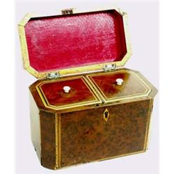A GEORGIAN YEW WOOD TWO DIVISION TEA CADDY string inlaid and with canted corners, the canister cover