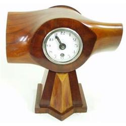 """A VINTAGE PROPELLER CLOCK with eight day movement by H W Elliott Ltd, England, 10.25"""" high £125-175."""