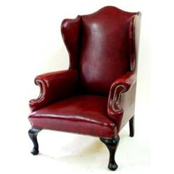 A GEORGIAN WING ARMCHAIR with scroll arms and cabriole front legs, upholstered in studded red leathe