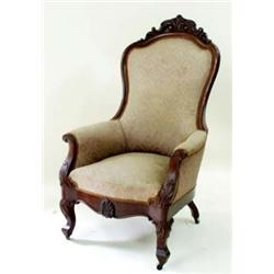 A VICTORIAN MAHOGANY ARMCHAIR with carved top rail, the arms with scroll ends, acanthus carved to kn