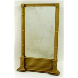 AN EARLY 19TH CENTURY GILT WALL MIRROR with breakfront pediment over a fluted frieze, with triple pi