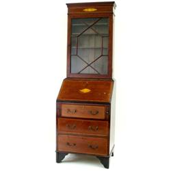 A SMALL EDWARDIAN MAHOGANY AND SATIN BANDED BUREAU BOOKCASE the top with moulded pediment over a gil