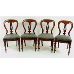 A SET OF FOUR LATE VICTORIAN MAHOGANY DINING CHAIRS with scroll carved crest rail and pierced and sh