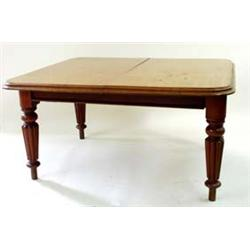 A VICTORIAN HONEY COLOURED MAHOGANY WIND OUT DINING TABLE the top with moulded edge over a plain fri