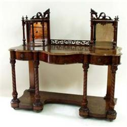 A FINE VICTORIAN BURR WALNUT DRESSING TABLE the swing mirror on pierced and scroll carved support, f
