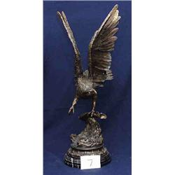 1 BRONZE-EAGLE WITH WINGS SPREAD ON ONE CLAW ON BRANCH WITH ADDED MARBLE BASE....