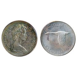 1967. ICCS Mint State-65. Medium heavy golden toning, with hints of blue. A Gem.