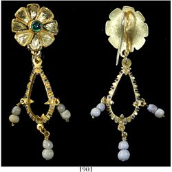 Ornate gold, pearl and emerald earring.