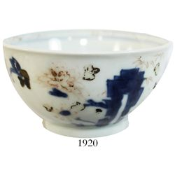 Chinese blue-on-white porcelain teacup, pavilion pattern.