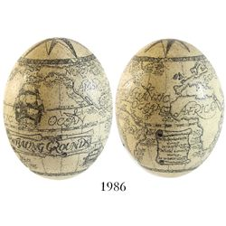Large ostrich egg with (modern) scrimshaw showing two voyages with locations of whales caught in the