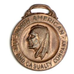 Antique advertising watch fob front marked North