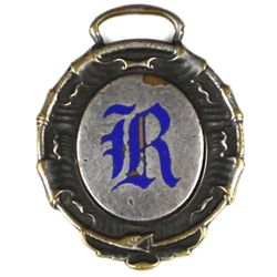 Antique advertising watch fob back marked