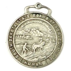 Antique advertising watch fob front marked South