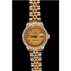 WATCH: St. Steel & 18KYG Ladies Rolex Oyster Perpetual Date watch with gold tone dial, date, and an