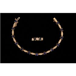 BRACELET: (1) Lady's 14ky blue sapphire & diamond link bracelet; 13 oval saphs, approx. 5.0mm x 3.95
