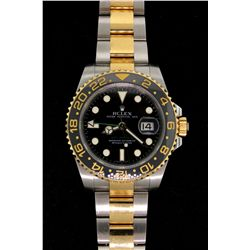 WATCH:  [1] 18ky and stainless steel gents Rolex GMT MASTER II watch with black dial, date and oyste