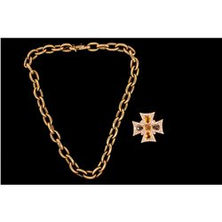 NECKLACE: (1)14ky oval link chain necklace with diamond and 14ky Maltese cross pendant. Chain is 18