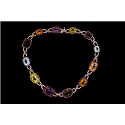 NECKLACE: (1) Diamond and multi-colored gemstone 18k WG necklace 16  long, set with (2) cushion shap