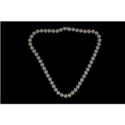 NECKLACE: (1) Diamond and 14k WG flower motif necklace, 17 inches long, prong set with (270) rbc dia