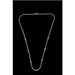NECKLACE: (1) Diamond and 18k WG tennis necklace 17  long. Set with (7) 3.5mm rbc diamonds and (93)