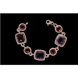 "BRACELET: (1) Pink tourmaline and amethyst, diamond bracelet in 18k WG 7 1/4"" long with (3) 14 x 16m"