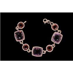 "BRACELET: (1) Pink tourmaline and amethyst, diamond bracelet in 18k WG 7 1/4"" long with (3) 14 x 16m"