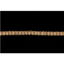 "BRACELET: (1) Diamond and 18ky and WG bracelet 7 1/2"" long x 8mm wide, bezel set with (33) princess"