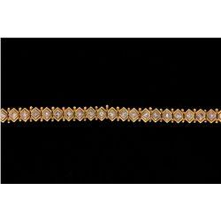 """BRACELET: (1) Diamond and 18ky and WG bracelet 7 1/2"""" long x 8mm wide, bezel set with (33) princess"""