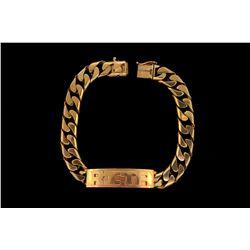 """BRACELET: (1) 14kGY gold ID bracelet 9 3/4"""" long x 12.2mm """"RITA"""" in the center 80.0g"""