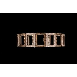 "BRACELET: (1) Ladies 18k WG diamond bracelet 7 1/4"" long of alternating white and champagne diamond"